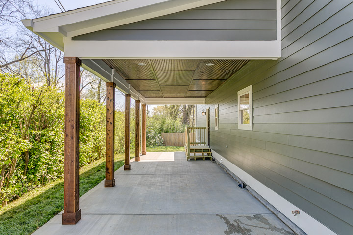 Covered Carport with cedar wrapped beams