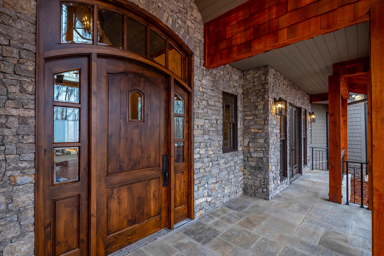 Knotty Alder front door with natural TN gray stone
